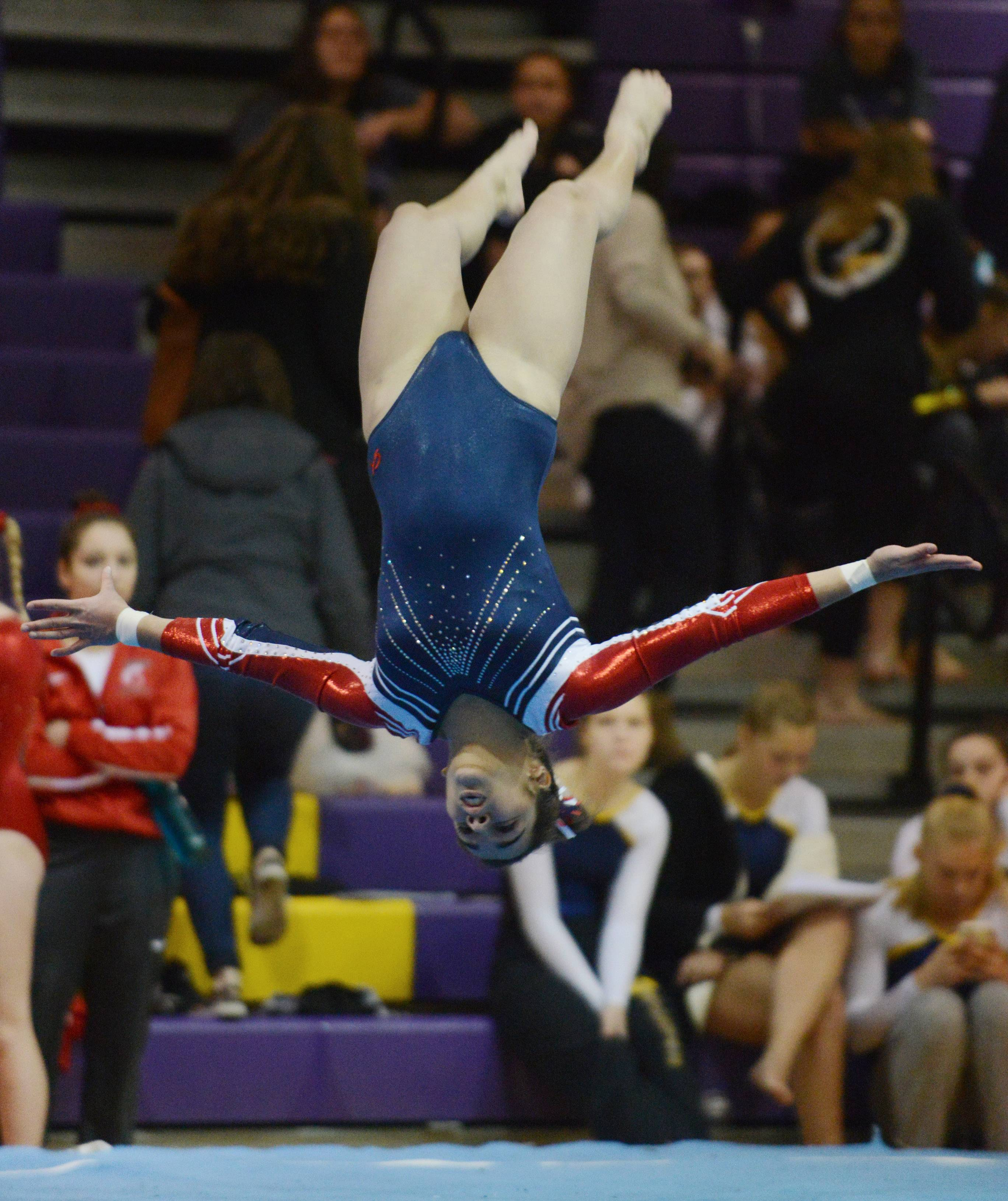 Conant's Mel Meyrick competes on the floor exercise during the Rolling Meadows invitational Saturday.