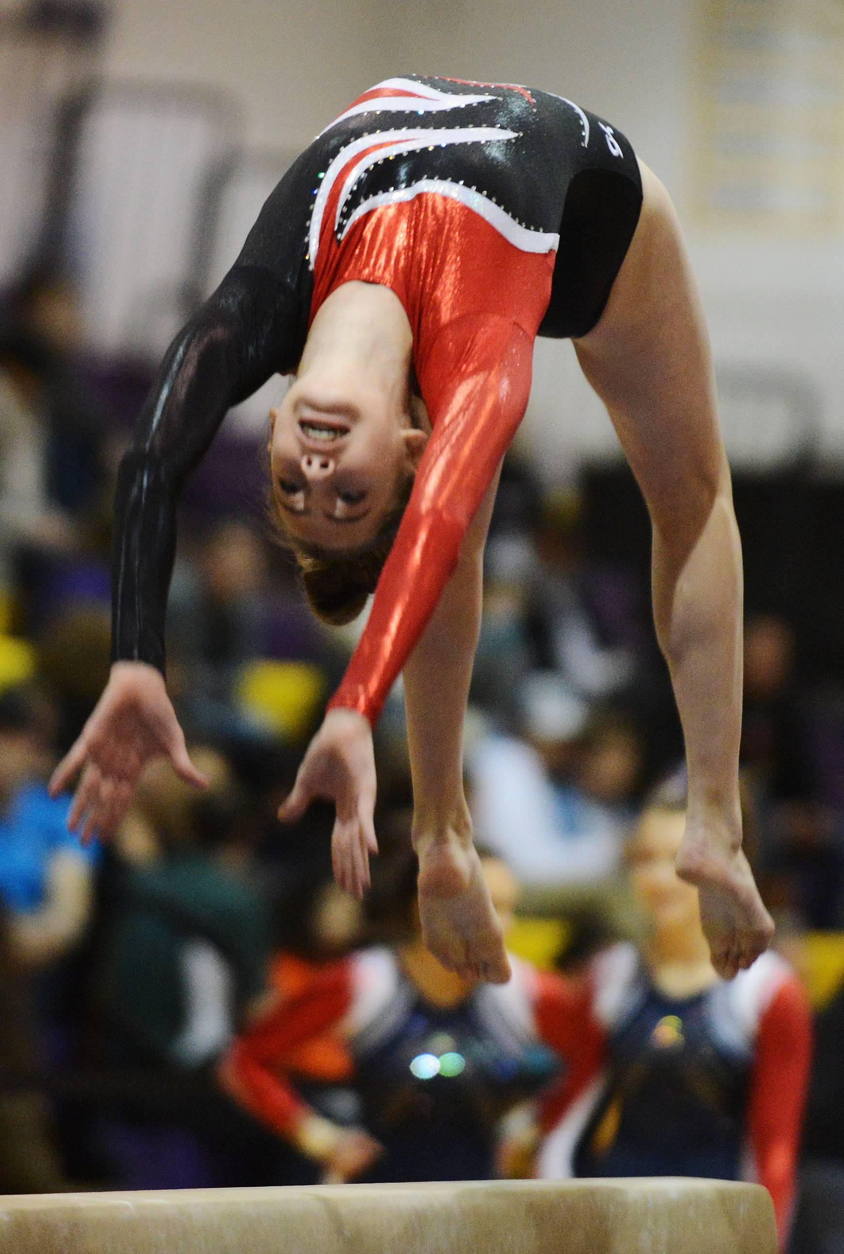 Barrington's Alana Riemenschneider competes on the balance beam during the Rolling Meadows invitational Saturday.