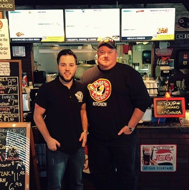 Richard Schweigel, right, with son Tim of Mount Prospect run Mother Cluckers restaurant in Chicago.