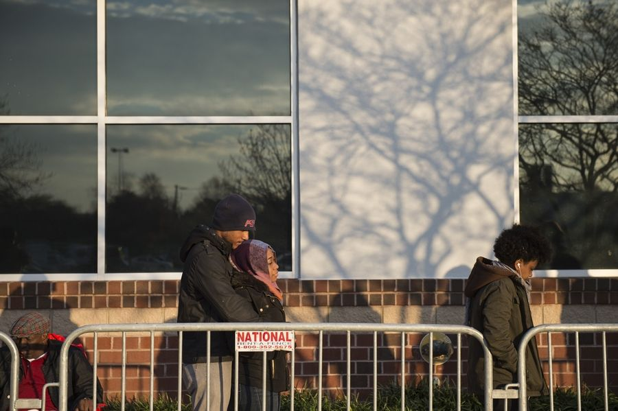 Gerrard Greene of Suitland, Md., and his girlfriend Cherrelle Elbourne wait in line to get a jump start on holiday bargains at Best Buy on Thanksgiving Day in Alexandria, Va., on Thursday.