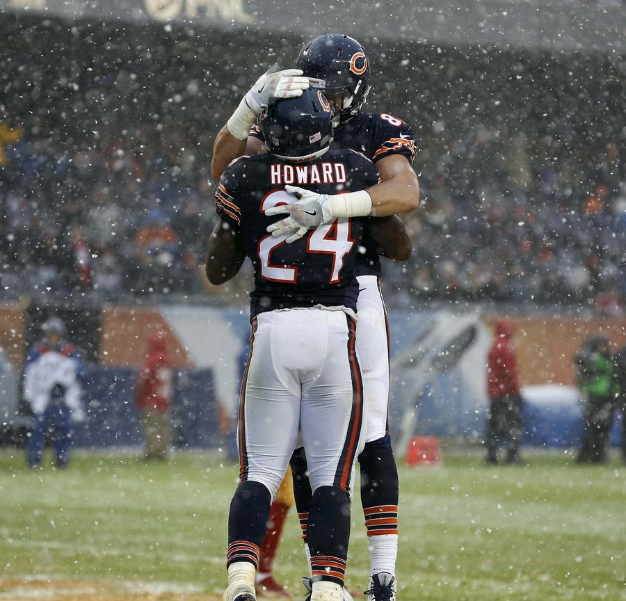 Chicago Bears running back Jordan Howard (24) is greeted by a teammate after scoring Sunday at Soldier Field in Chicago.
