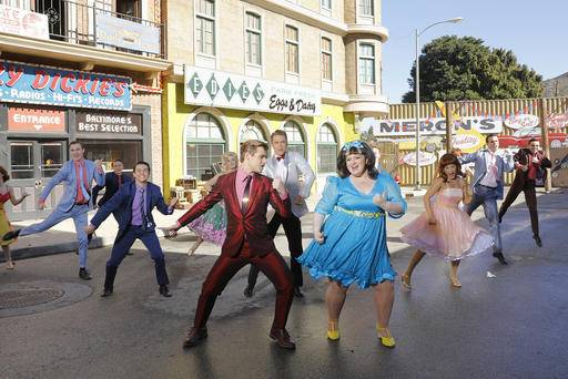 "Derek Hough as Corny Collins, foreground left, and Maddie Baillio as Tracy Turnblad, foreground right, during a rehearsal for the musical ""Hairspray Live!,"" airing on Wednesday, Dec. 7. Sets for the musical were designed by Broadway set designer Derek McLane."