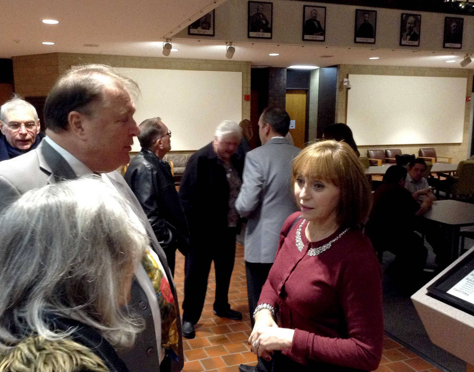 "DuPage County Board member Elizabeth ""Liz"" Chaplin, right, talks to supporters before being sworn in Monday night at an inauguration event in Wheaton. Chaplin is the only Democrat on the 18-member county board."