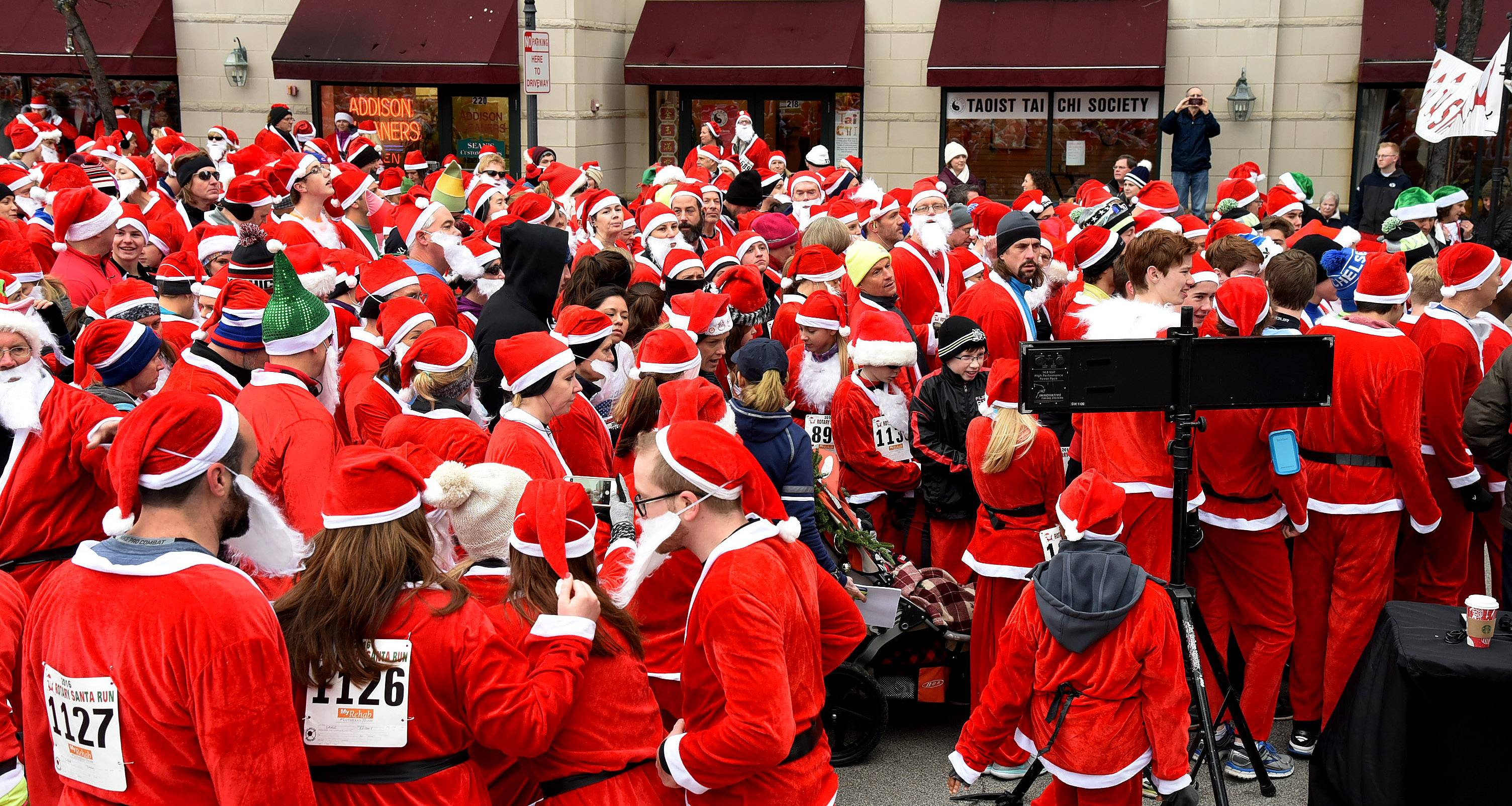 Runners squeeze through the starting line for the annual Rotary Santa Run in downtown Arlington Heights.
