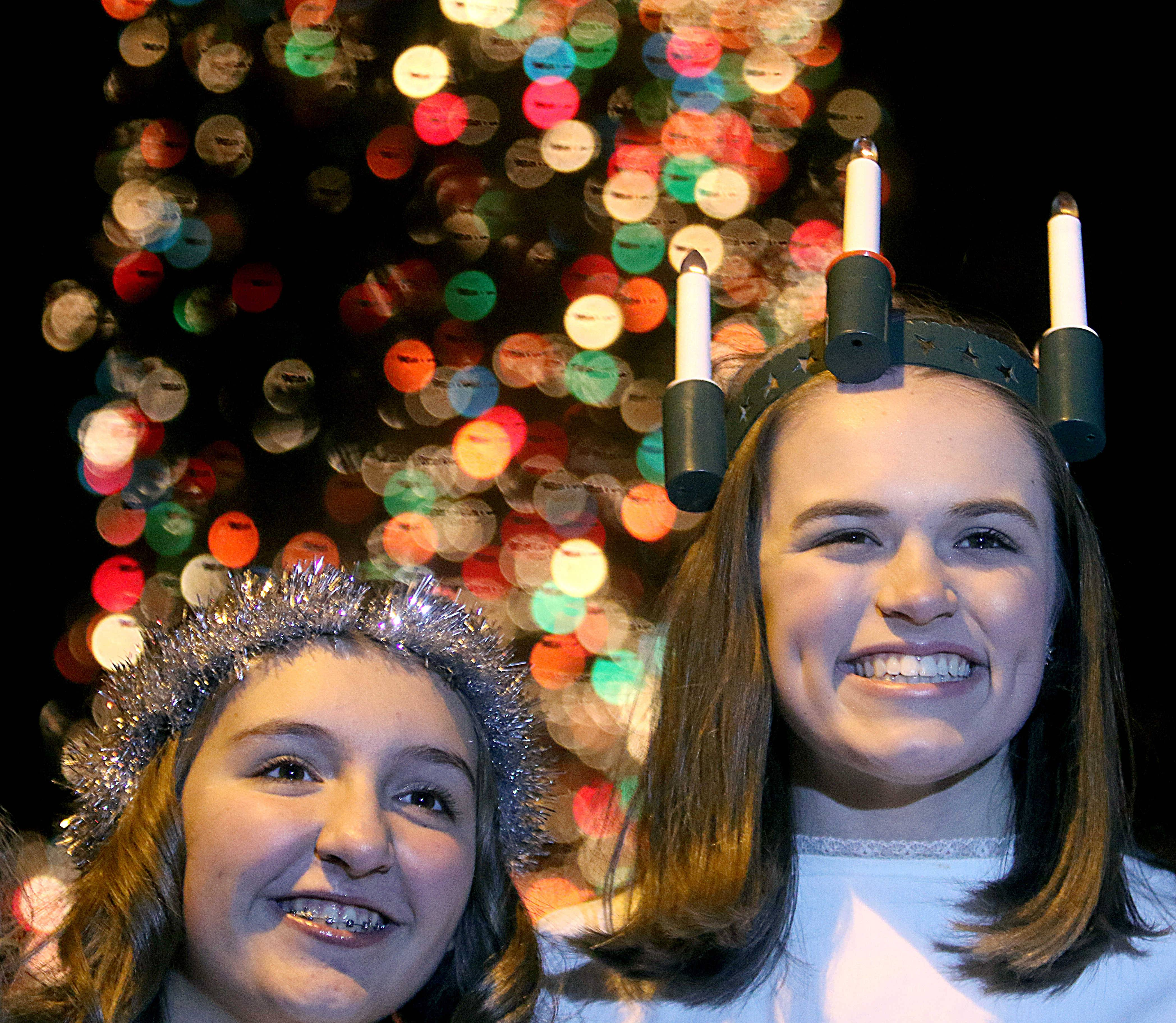 Anna Fintzen, 15, right, of Geneva plays the part of Santa Lucia as Lucy Bridges, 13, left, plays a Santa Lucia attendant on Friday during the Christmas Walk Weekend festivities in downtown Geneva.