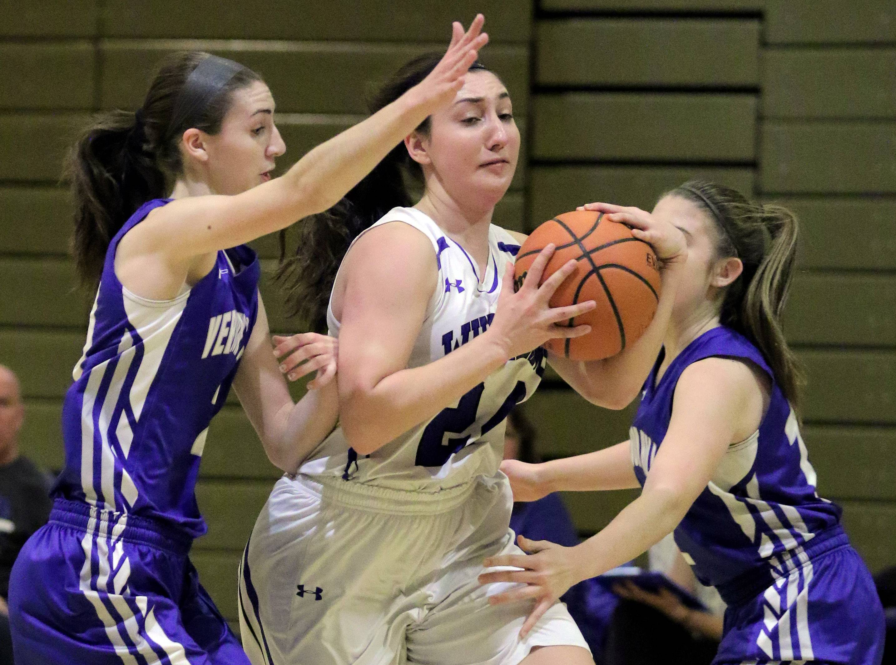 Wheeling's Melissa Carver, middle, tries to split through Vernon Hills' Sophia Lehocky, left, and Piper Bedell.