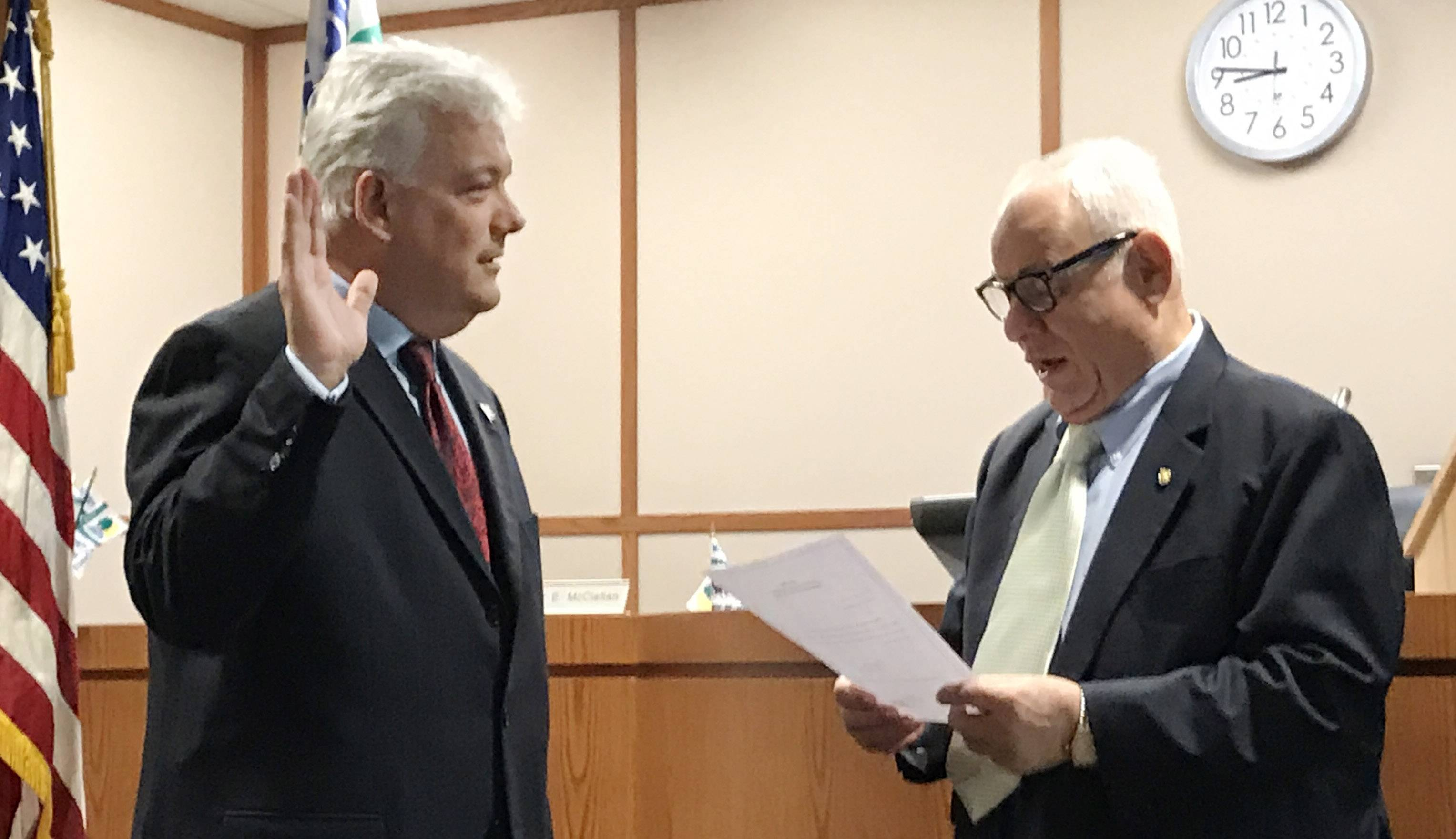 Jack Franks is sworn in Monday as the first popularly elected McHenry County Board chairman by his father, Herb Franks.