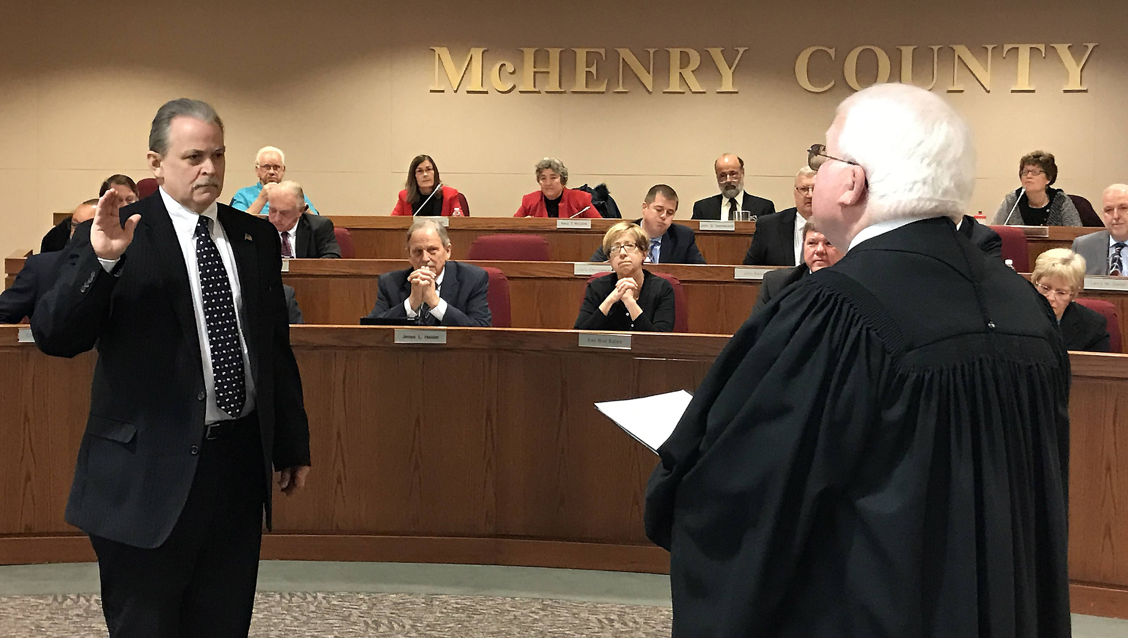 McHenry County Board member Jeff Thorsen is sworn in Monday as board vice chairman by Chief Judge Michael Sullivan.