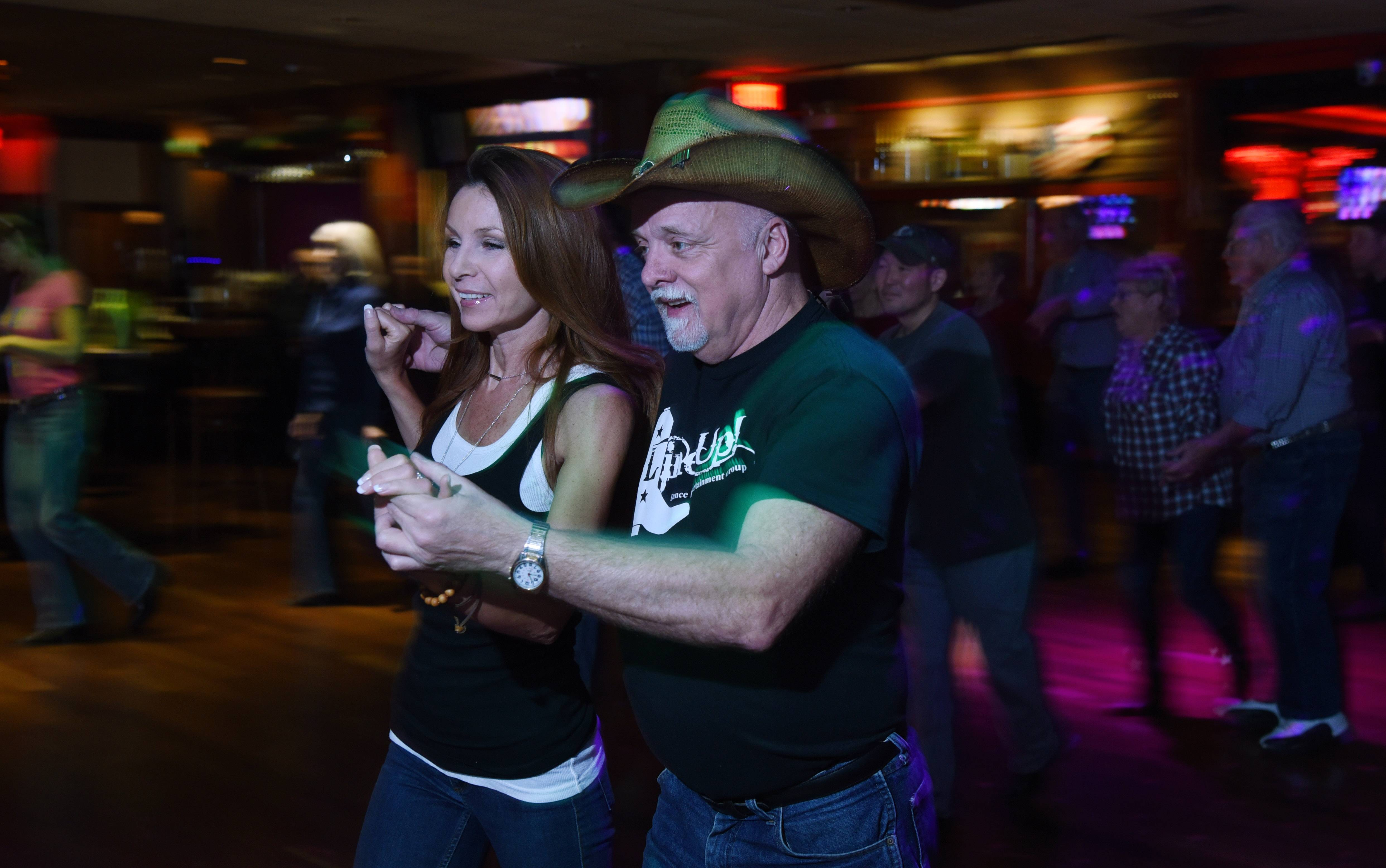 Kat Jackowska of Downers Grove dances with Keith Noltkamper of Des Plaines at Lucky Star in Bartlett.