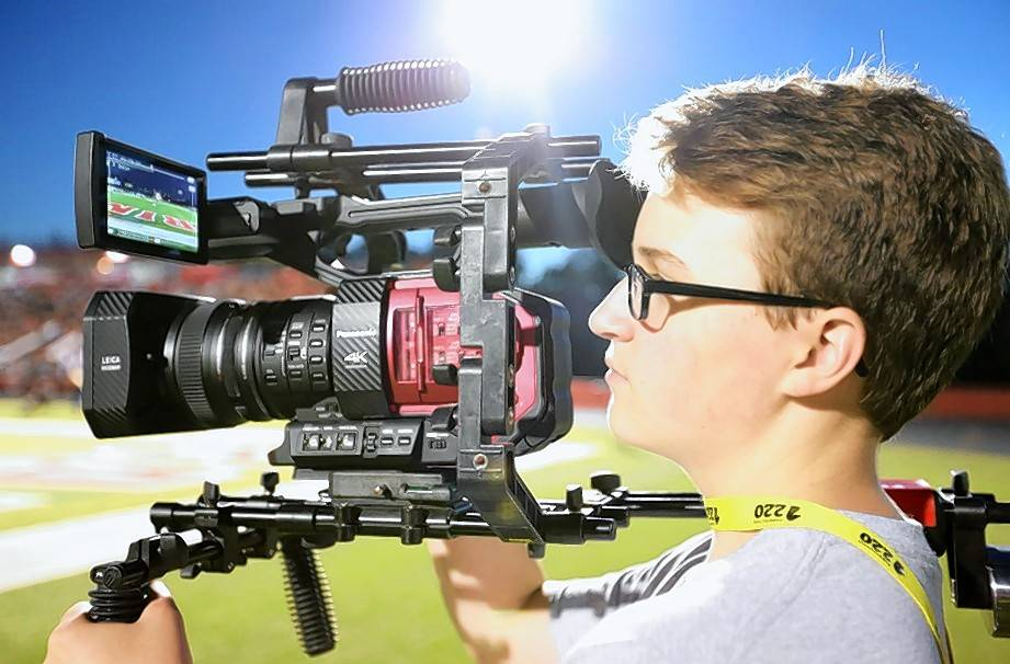 A BHS-TV student records video at a Barrington Area Unit School District 220 football game.