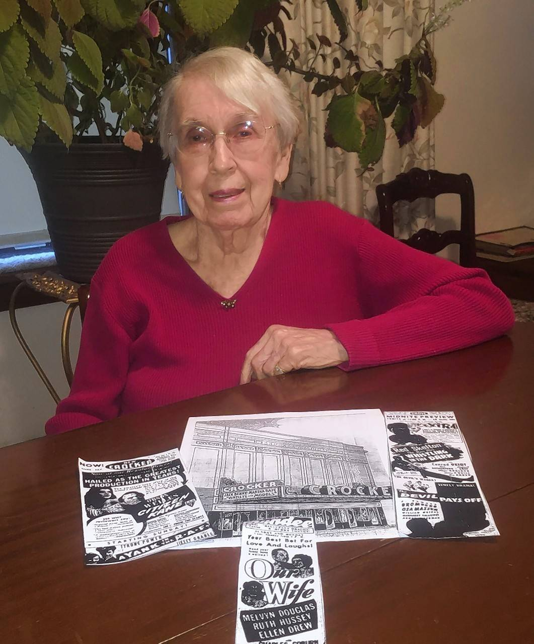 Helen Childs sits in front of a picture of Elgin's Crocker Theater and ads for shows that were playing on Dec. 7, 1941. Childs and her husband, George, had just left the theater when they heard the news that Pearl Harbor was attacked.