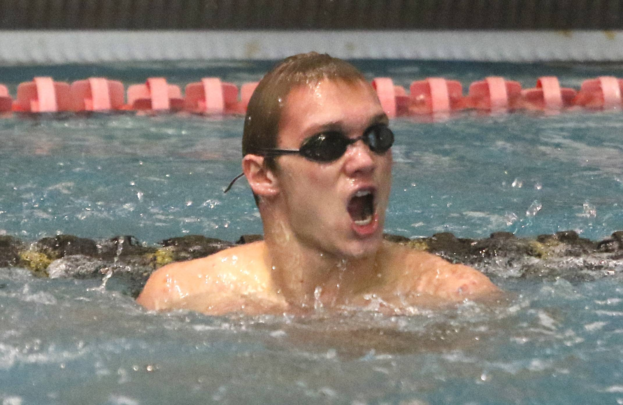 Naperville Central's Philip Sajaev celebrates a first place finish in the 200 Yard Medley Relay during the Metea Valley boys swimming sectional.