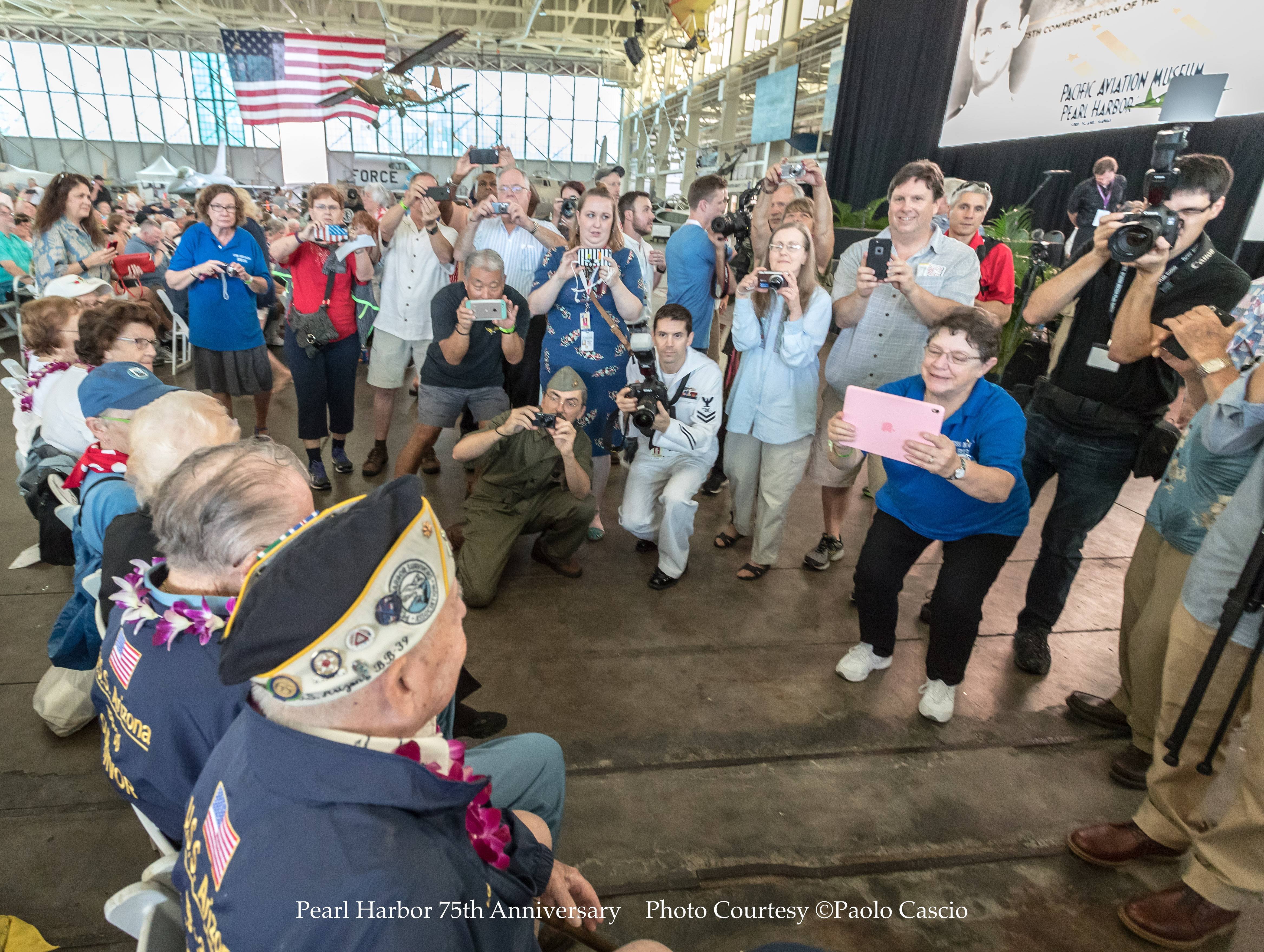 "Touring Pearl Harbor with four remaining survivors of the attack that sunk the USS Arizona is ""like touring with the Beatles,"" says Paolo Cascio, a Schaumburg photographer who has spent five years working on this project and will turn it into a coffee-table book. The survivors, all in their mid-90s, sign autographs and pose for photos."