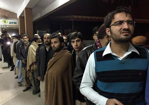 People gather outside the emergency ward, where authorities brought the bodies of plane crash victims, at a hospital, in Abbottabad, Pakistan, Wednesday, Dec. 7, 2016. Pakistan's national carrier says one of its planes has crashed shortly after takeoff from the northern city of Chitral with 48 people aboard. A spokesman for Pakistan's Civil Aviation Authority said Wednesday that the cause of the crash was unclear and there was believed to be little chance of finding survivors. (AP Photo/B.K. Bangash)