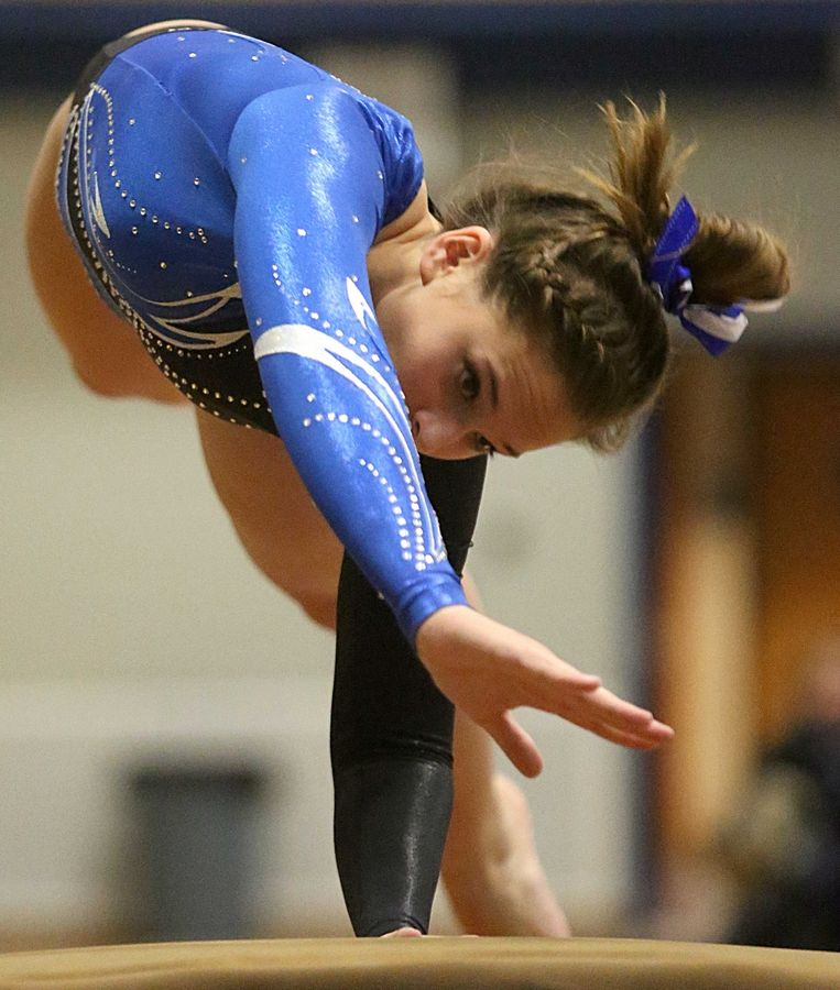Geneva's Gracie DeVita competes on the vault during varsity gymnastics action at Mack Olson Gym on the campus of Geneva High School Wednesday night.