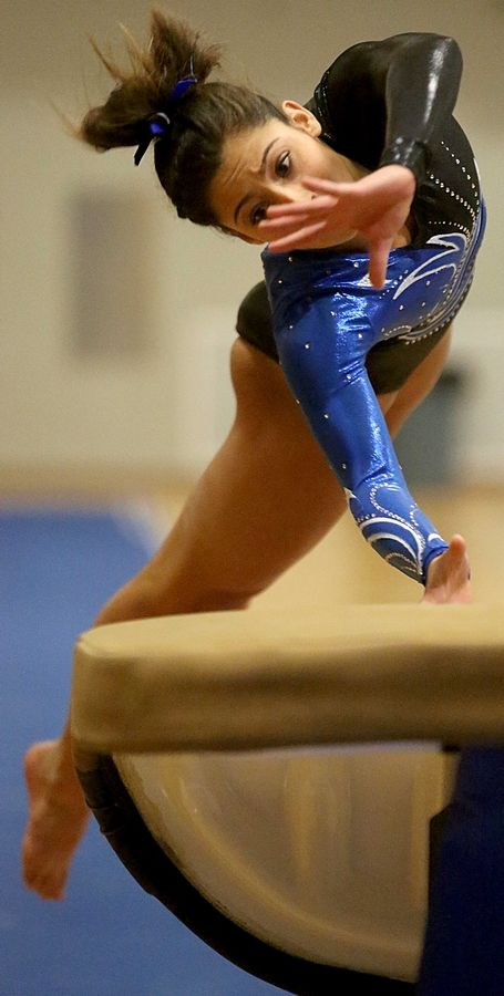 Geneva's Claire Ginsberg competes on the vault during varsity gymnastics action at Mack Olson Gym on the campus of Geneva High School Wednesday night.