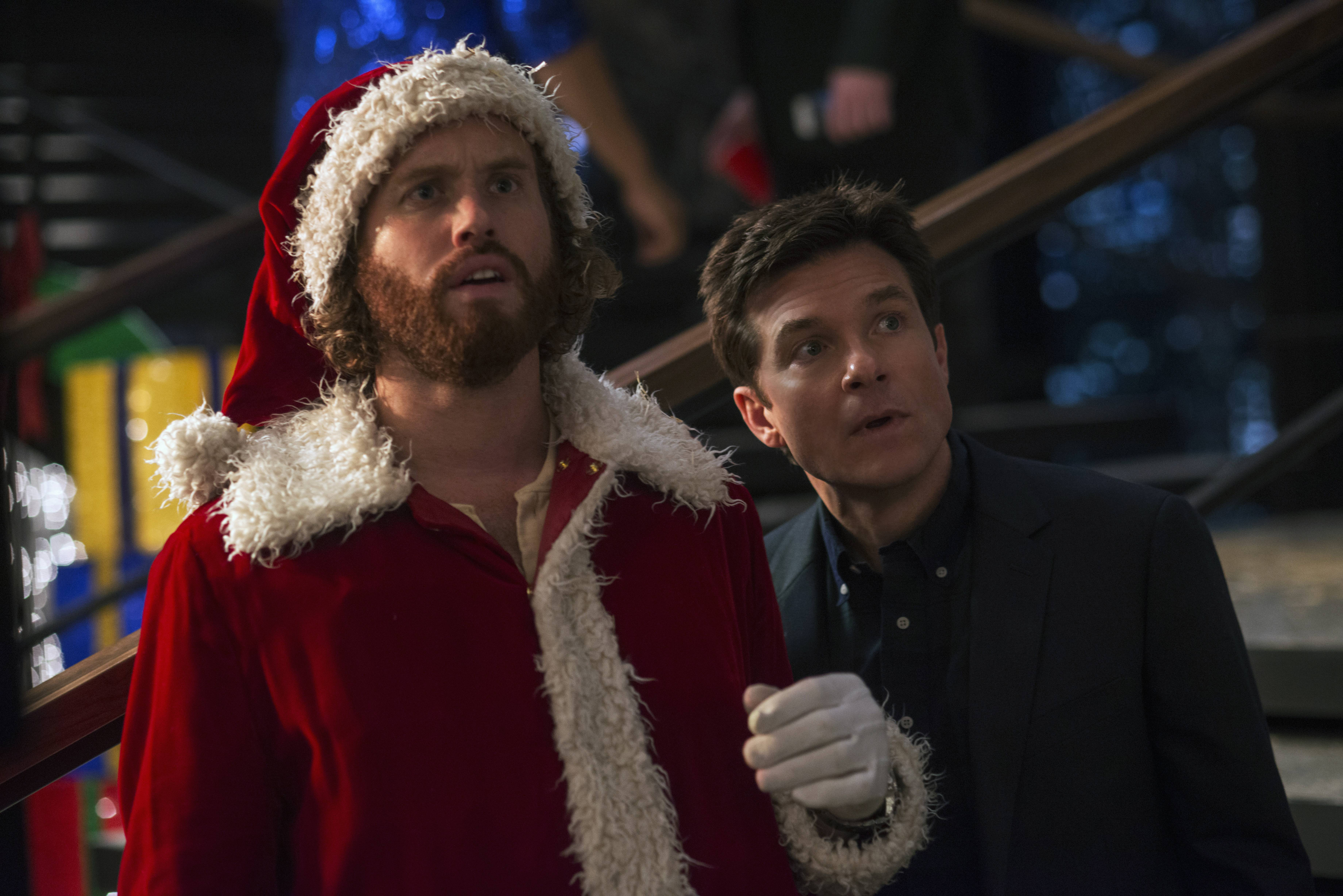 "Clay Vanstone (T.J. Miller, left) and Josh Parker (Jason Bateman) try to save their tech firm from layoffs in the raunchy ""Office Christmas Party."""