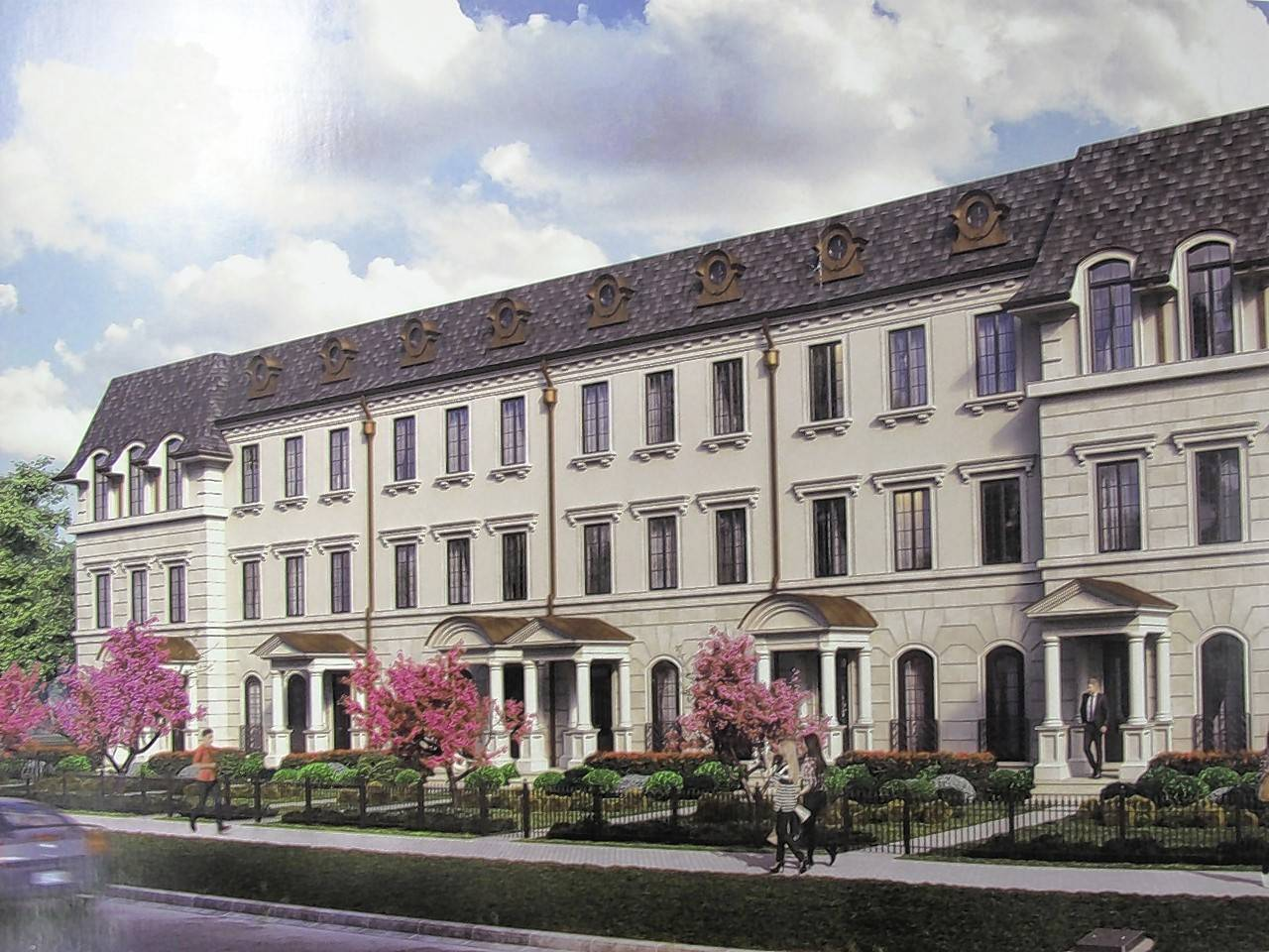 Charleston Row is inspired by a design from London that builder Larry Van Someren saw at a convention in Chicago. The string of six row houses along Aurora Avenue at Webster Street in downtown Naperville is expected to be complete by spring or summer 2018.