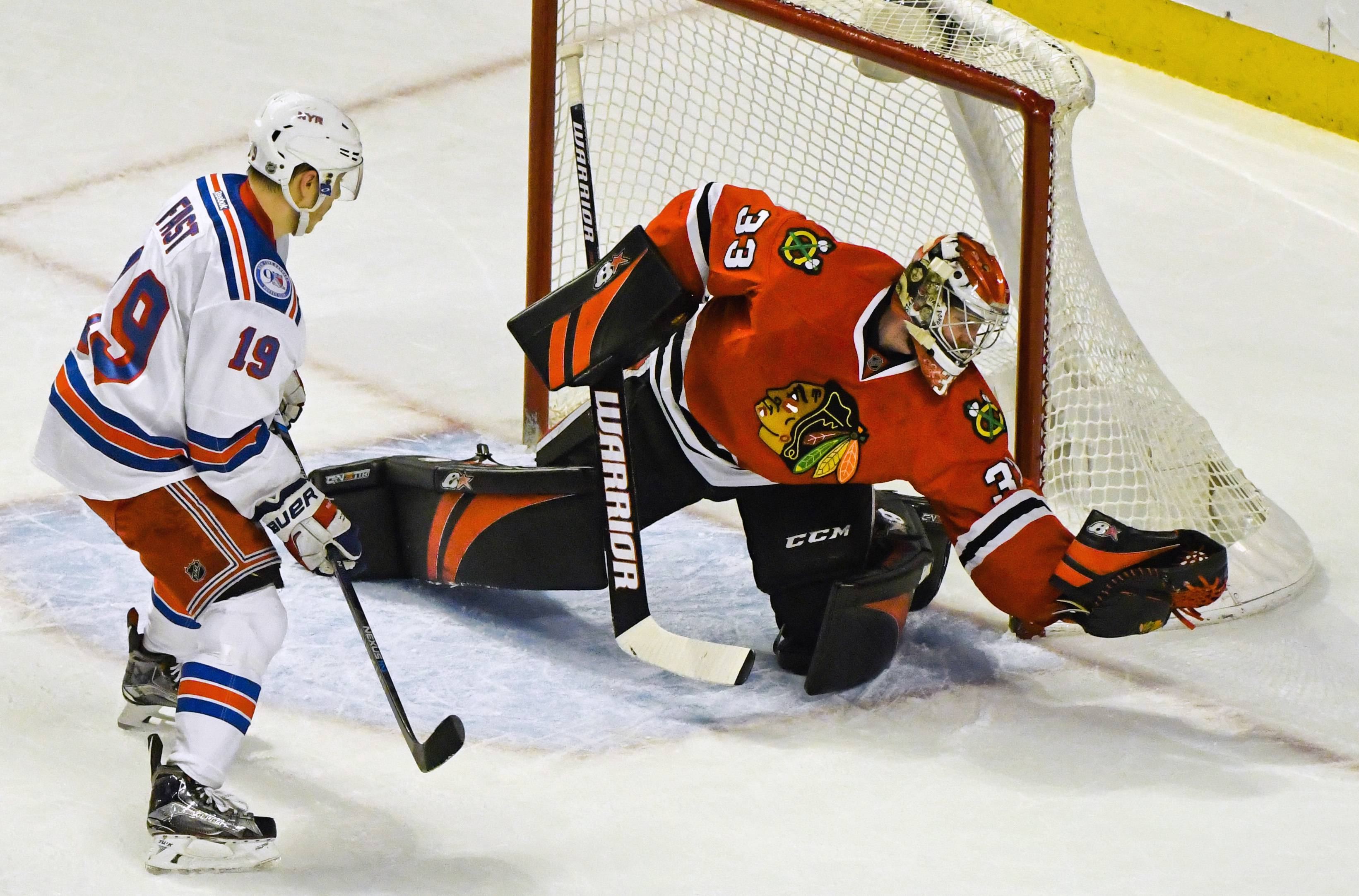 Scott Darling was stellar in goal for the Blackhawks Friday night making 36 saves. But the New York Rangers won 55 seconds into extra time when Nick Holden finally beat Darling with the Rangers' 37th shot of the night.