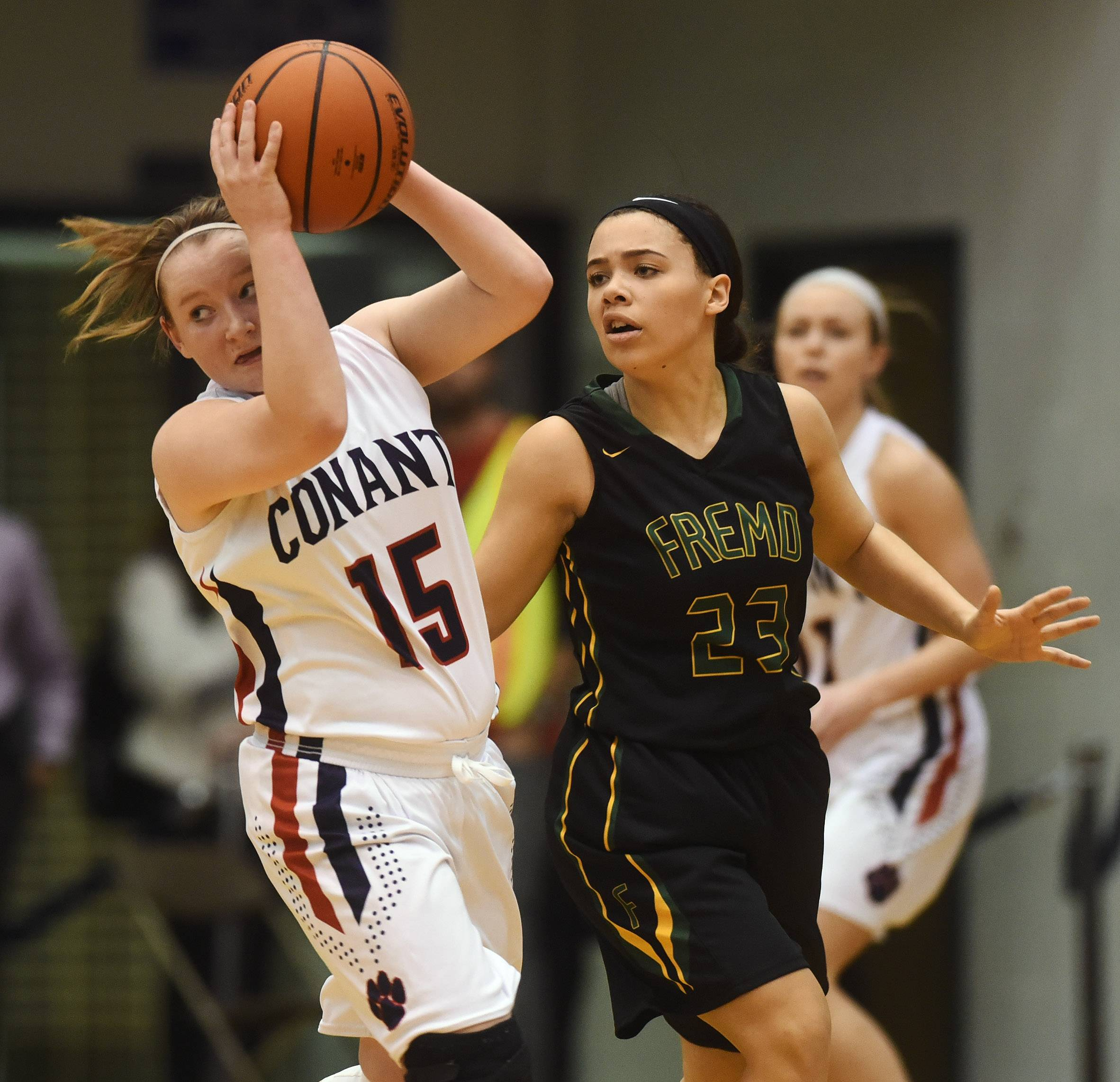 Conant's Cate Fitzgerald, left, looks for an open teammate while being pressured by Fremd's Hayley Williams during Friday's game in Hoffman Estates.