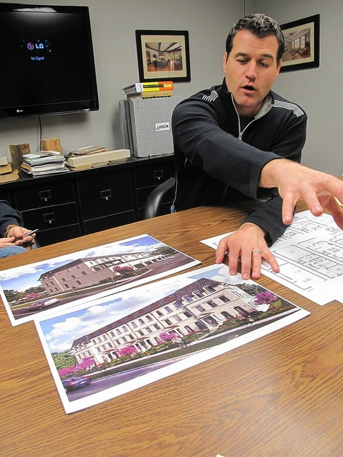 Erik Van Someren of Charleston Building & Development points out amenities at Charleston Row, a six-unit row house development the company is planning for Aurora Avenue at Webster Street in downtown Naperville.