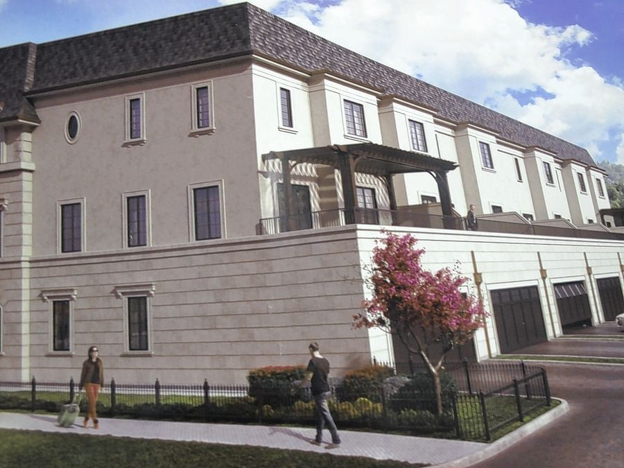 The back of a downtown Naperville row house development called Charleston Row will include second-story and fourth-story rooftop terraces for each of the six units, which are priced between $1.1 million and $1.3 million.