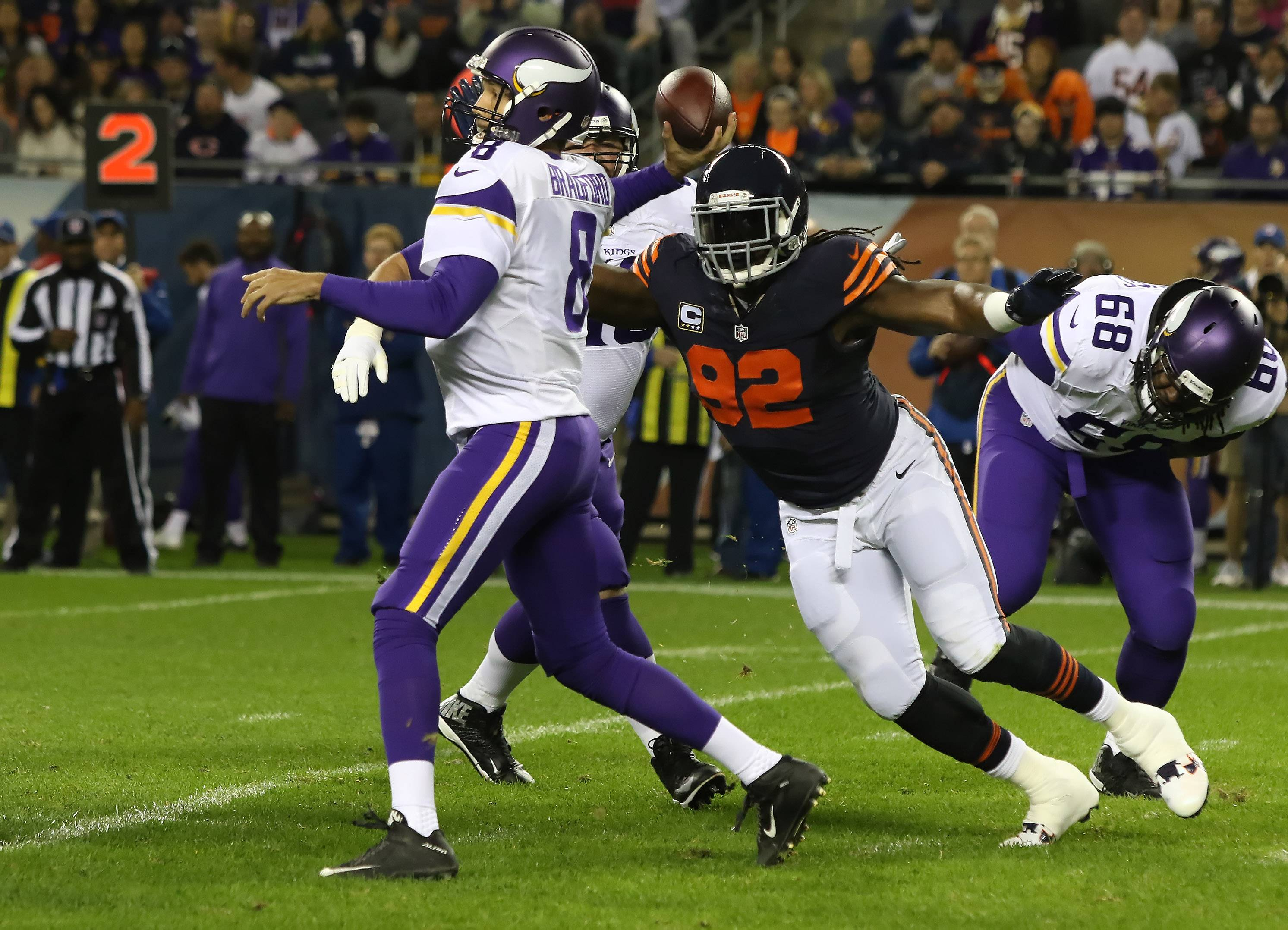 Minnesota Vikings quarterback Sam Bradford (8) is pressured by Chicago Bears outside linebacker Pernell McPhee (92) as he throws the ball in the first half during the NFL football game between the Chicago Bears and the Minnesota Vikings at Soldier Field in Chicago on Monday night.