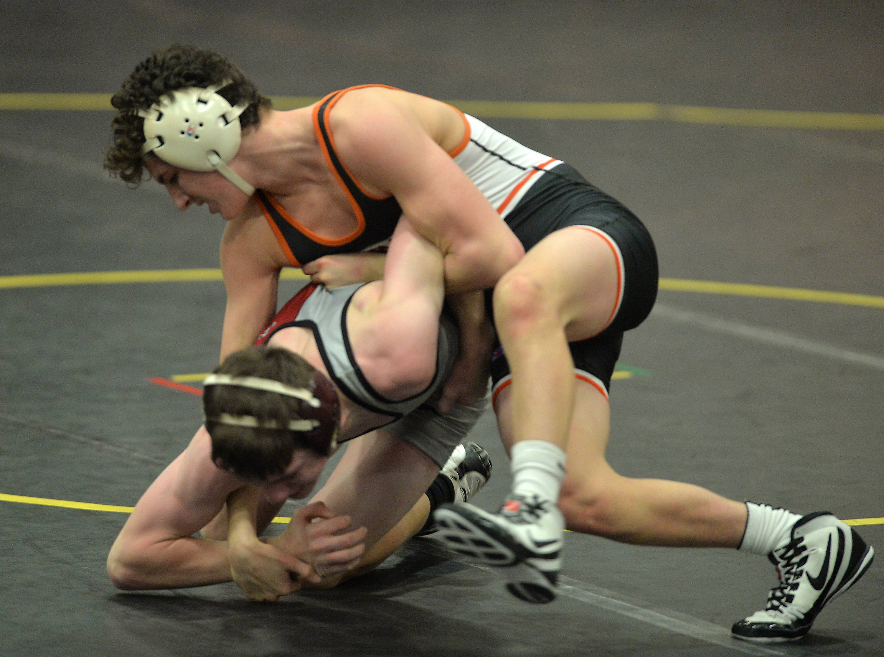 St. Charles East's Justin Benjamin gains control of Antioch's Wally Marsh in their 126-pound match Saturday in a quad meet at Sycamore High School. Benjamin won the contest by fall.