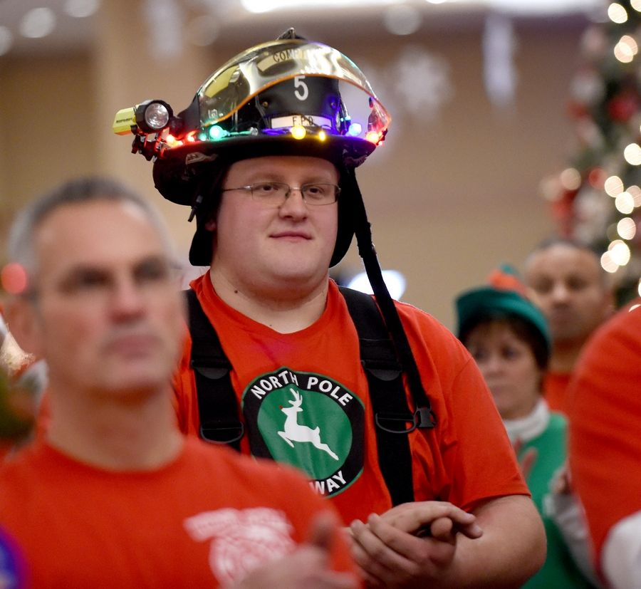 Compton firefighter Ethan Orzech traveled about 100 miles each way to help out with the annual Operation North Pole Christmas Party for seriously ill children and their families Saturday at the Donald E. Stephens Convention Center in Rosemont.