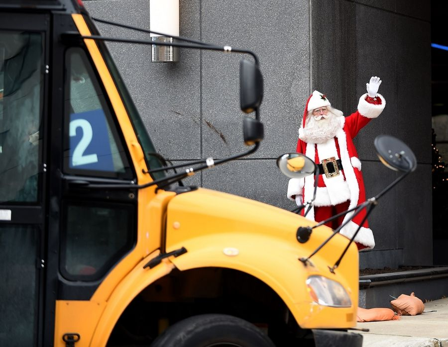 Santa -- on loan from Santa's Village in East Dundee -- greets the buses arriving for the annual Operation North Pole Christmas Party. The celebration for seriously ill children and their families was Saturday at the Donald E. Stephens Convention Center in Rosemont.