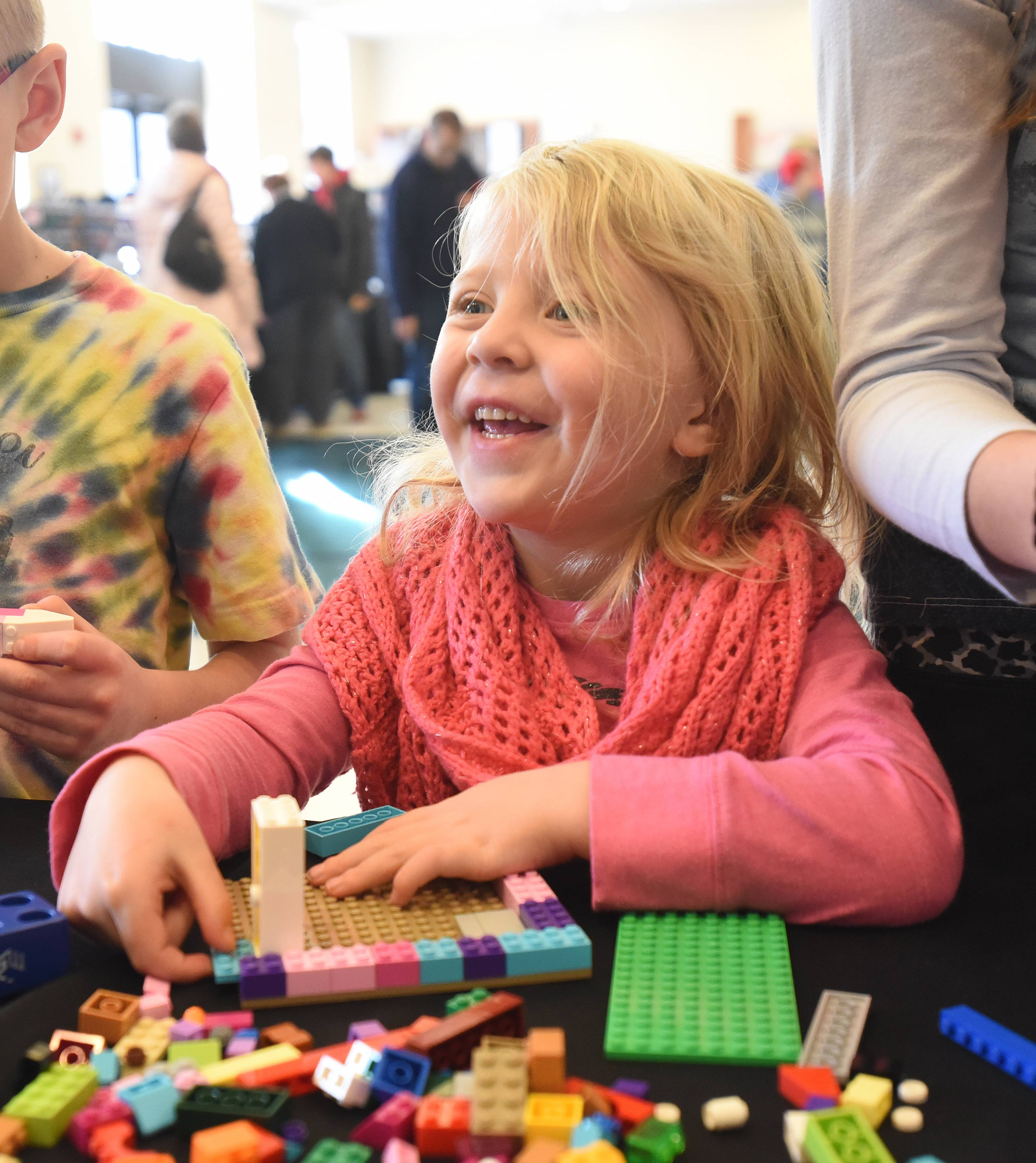 Lelia Gallup, 4, of Indiana starts building during the Northern Illinois Lego Train Club's annual show Saturday at Cantigny Park Saturday. The show continues Sunday.
