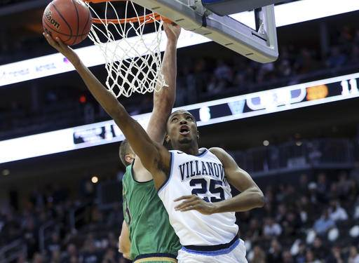 Villanova's Mikal Bridges (25) takes a shot during the first half of an NCAA college basketball game against Notre Dame, Saturday, Dec. 10, 2016, in Newark, N.J. (AP Photo/Mel Evans)