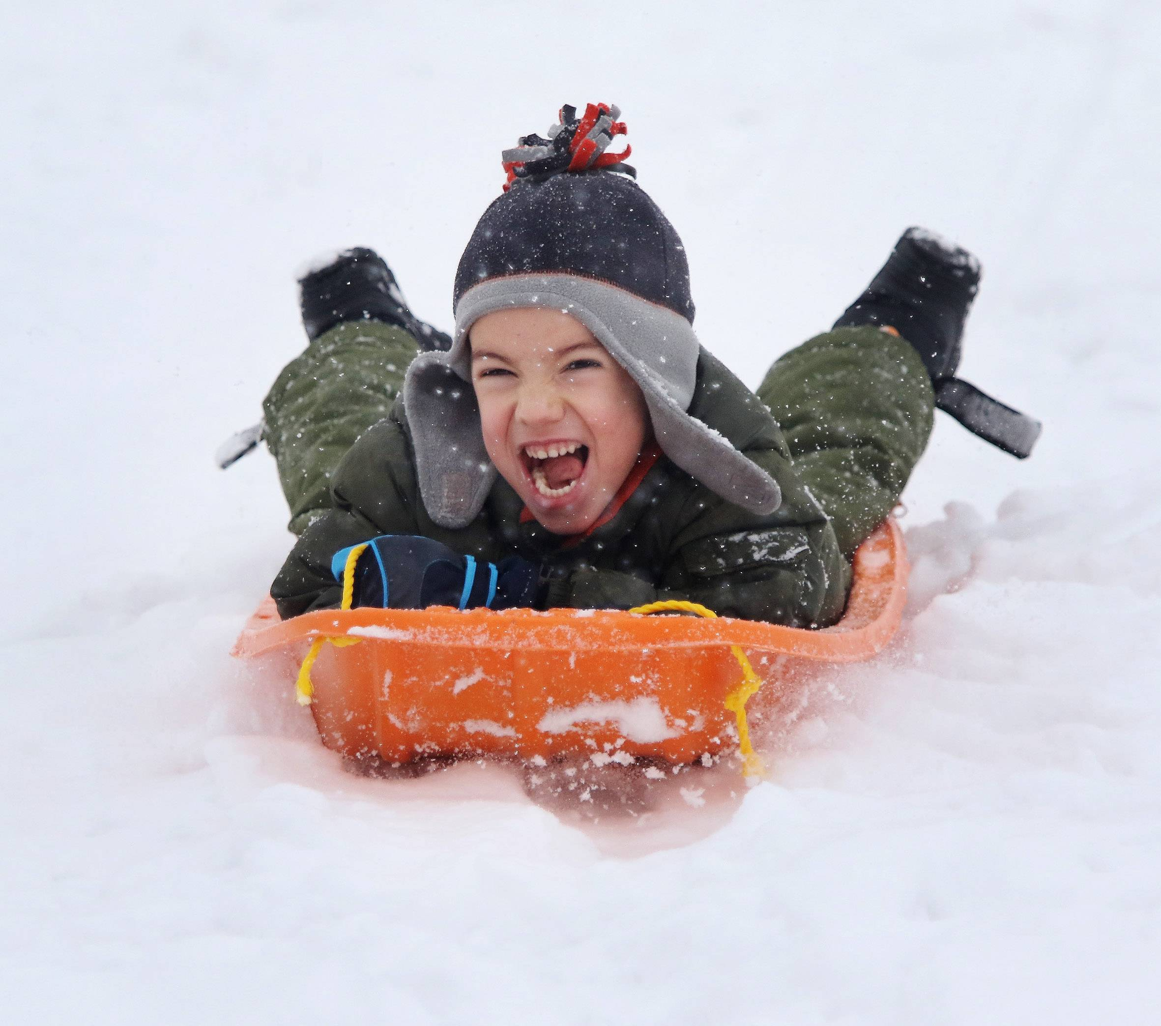 Five-year-old Patrick Clauser of Vernon Hills flies down the sledding hill at Century Park in Vernon Hills on Sunday. Almost 10 inches of snow in Cook and Lake counties over the weekend.