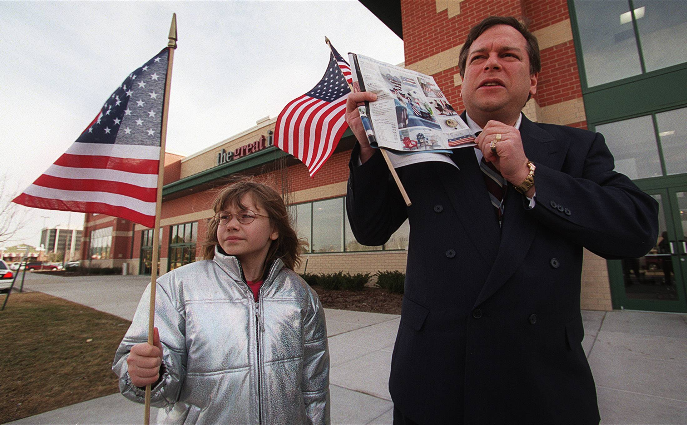 Rob Sherman and his then-8-year-old daughter, Dawn, hold a news conference outside a Schaumburg store to protest the selling of floor mats with American flag symbolism on them.