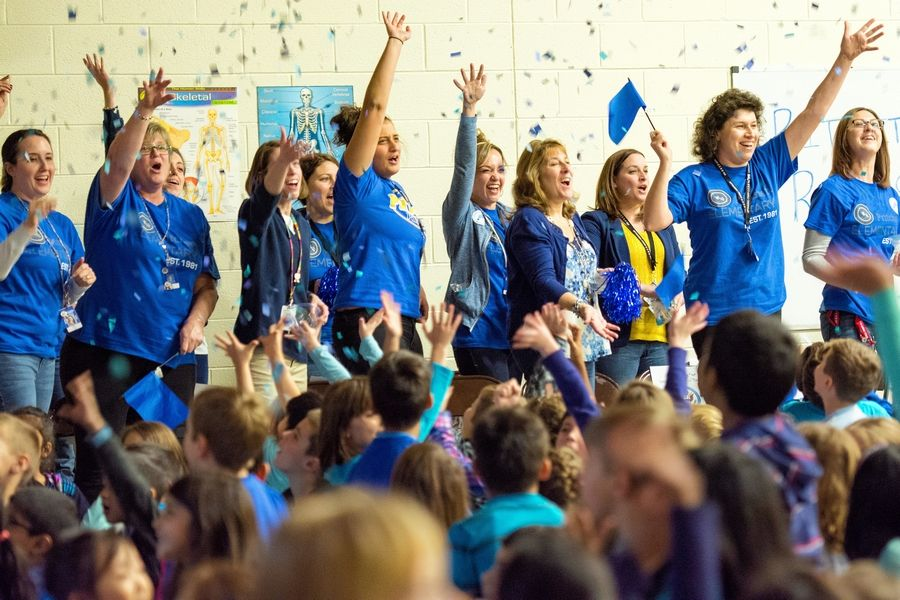 Pritchett Elementary School teachers throw confetti during an all-school assembly Tuesday celebrating the school's award.