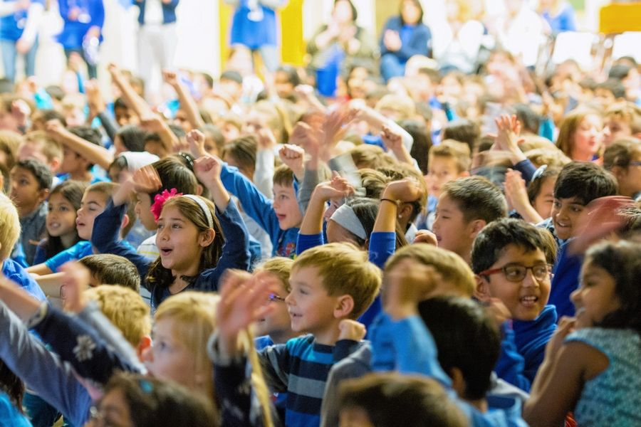 Students celebrate Tuesday at an assembly recognizing Pritchett Elementary School's National Blue Ribbon School award.