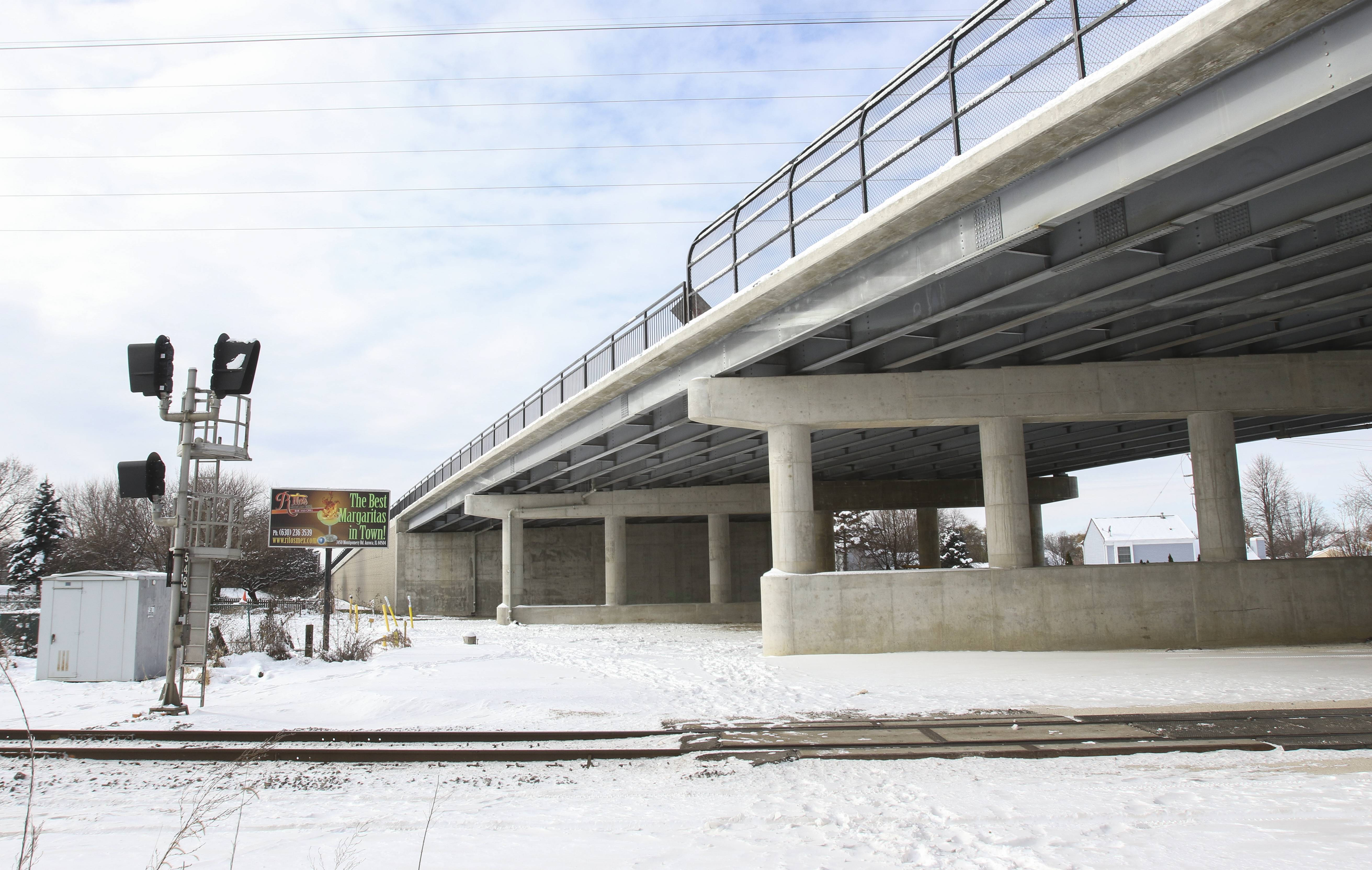 A new bridge carries Route 34 over the Canadian National railroad in Aurora, where two teens were killed when a train struck their car in 1999. Now, two lanes of traffic in each direction as well as bicyclists and people on foot can continue on their way while an average of 42 trains a day pass below.