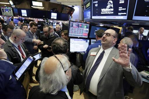 Specialist Peter Giacchi, right, calls out prices during the IPO of WildHorse Resource Development on the floor of the New York Stock Exchange, Wednesday, Dec. 14, 2016. Stocks are little changed on Wall Street in early trading, a day after indexes set their latest all-time highs.