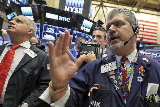 Trader John Panin, right, works on the floor of the New York Stock Exchange, Wednesday, Dec. 14, 2016. Stocks are little changed on Wall Street in early trading, a day after indexes set their latest all-time highs.