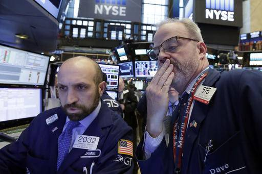 Specialist James Denaro, left, and trader David O'Day work on the floor of the New York Stock Exchange, Wednesday, Dec. 14, 2016. Stocks are little changed on Wall Street in early trading, a day after indexes set their latest all-time highs.