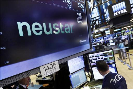 The logo for Neustar, a provider of real-time information services, appears above a trading post on the floor of the New York Stock Exchange, Wednesday, Dec. 14, 2016.