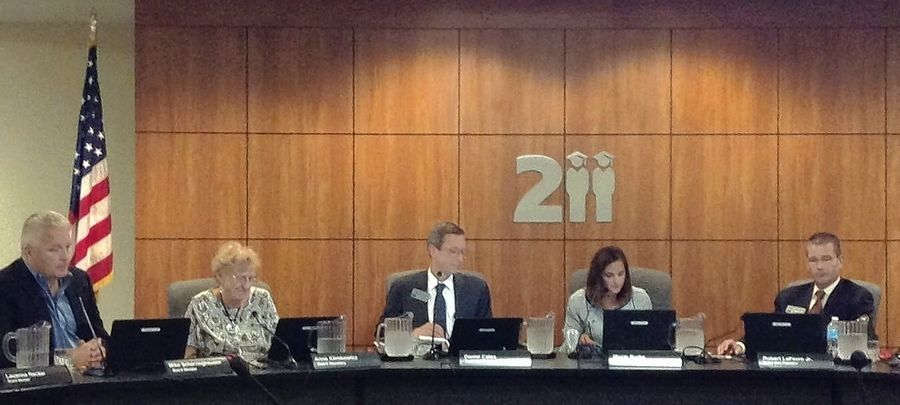 Palatine Schaumburg High School District 211 board members and administrators discuss the possibility of video recording and broadcasting their meetings earlier this year.