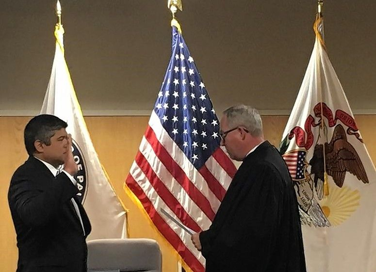 Aaron Del Mar, shown being sworn in as Palatine Township highway commissioner in May, was appointed by Gov. Bruce Rauner to a $20,000-a-year job on the Illinois International Port District Board.