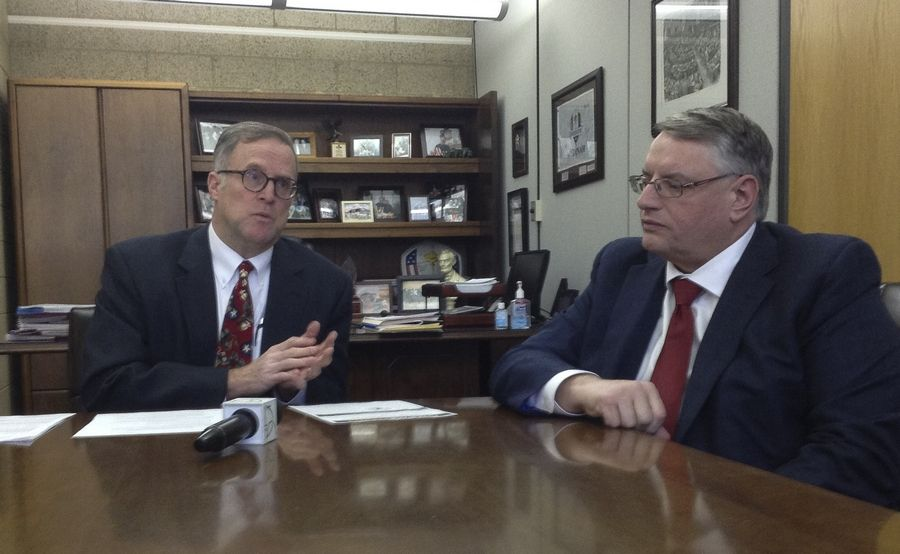 DuPage County Board Chairman Dan Cronin, left, and county Clerk Paul Hinds talk about a plan to merge the clerk's office with the DuPage Election Commission.