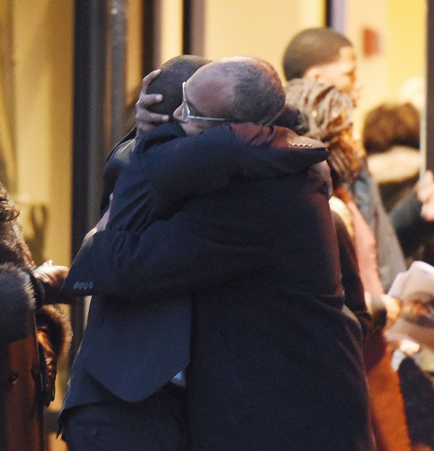 Paul Michna/pmichna@dailyherald.comMourners hug outside the church after the funeral service for Ron Allen of Naperville, a 73-year-old Democratic precinct committeeman and community activist. He was laid to rest at 2 p.m. Saturday at DuPage AME Church in Lisle. Allen was shot to death while driving early Dec. 2 in Chicago.