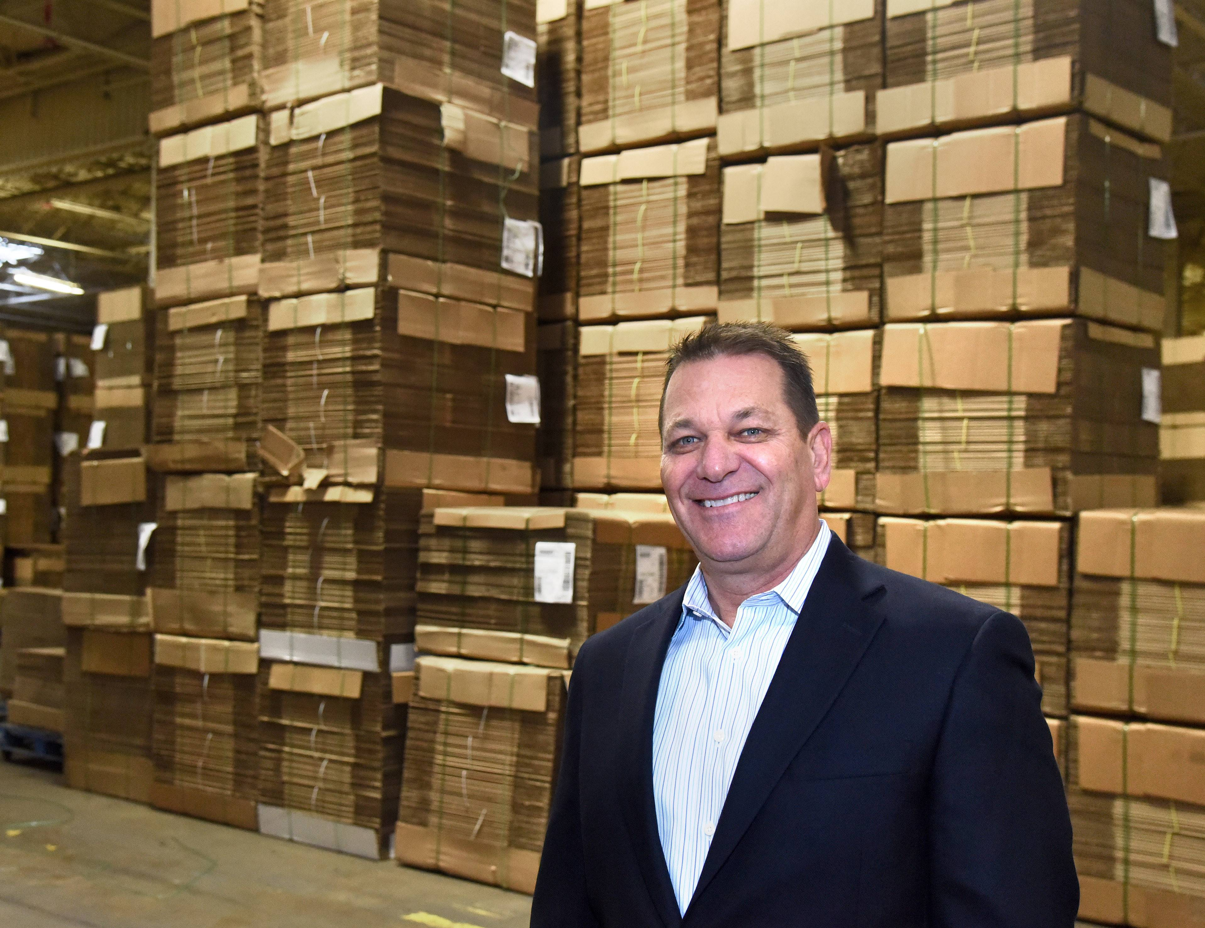 Mike Hrbacek, owner of The Packaging Wholesalers, inside his warehouse in Elgin. He invested $5.4 million of renovations into the building.