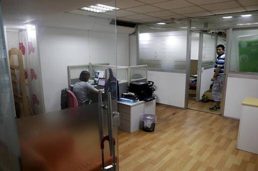 managers office design dea. In This Sept. 21, 2016 Photo, A Worker Looks Out From The Shanghai Managers Office Design Dea G