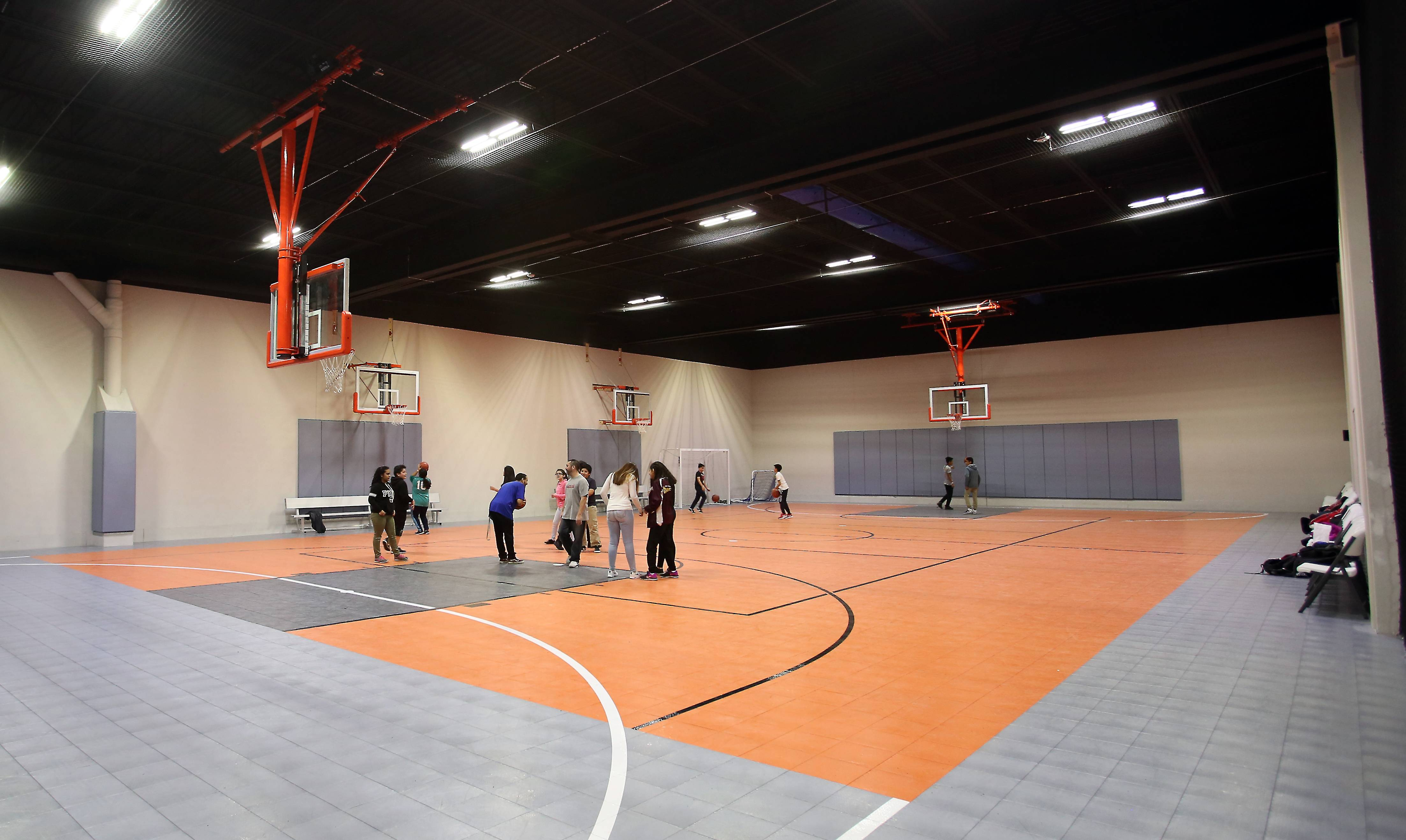 Students play on of the basketball courts at LifeZone 360, the highly anticipated new sports complex in West Dundee.