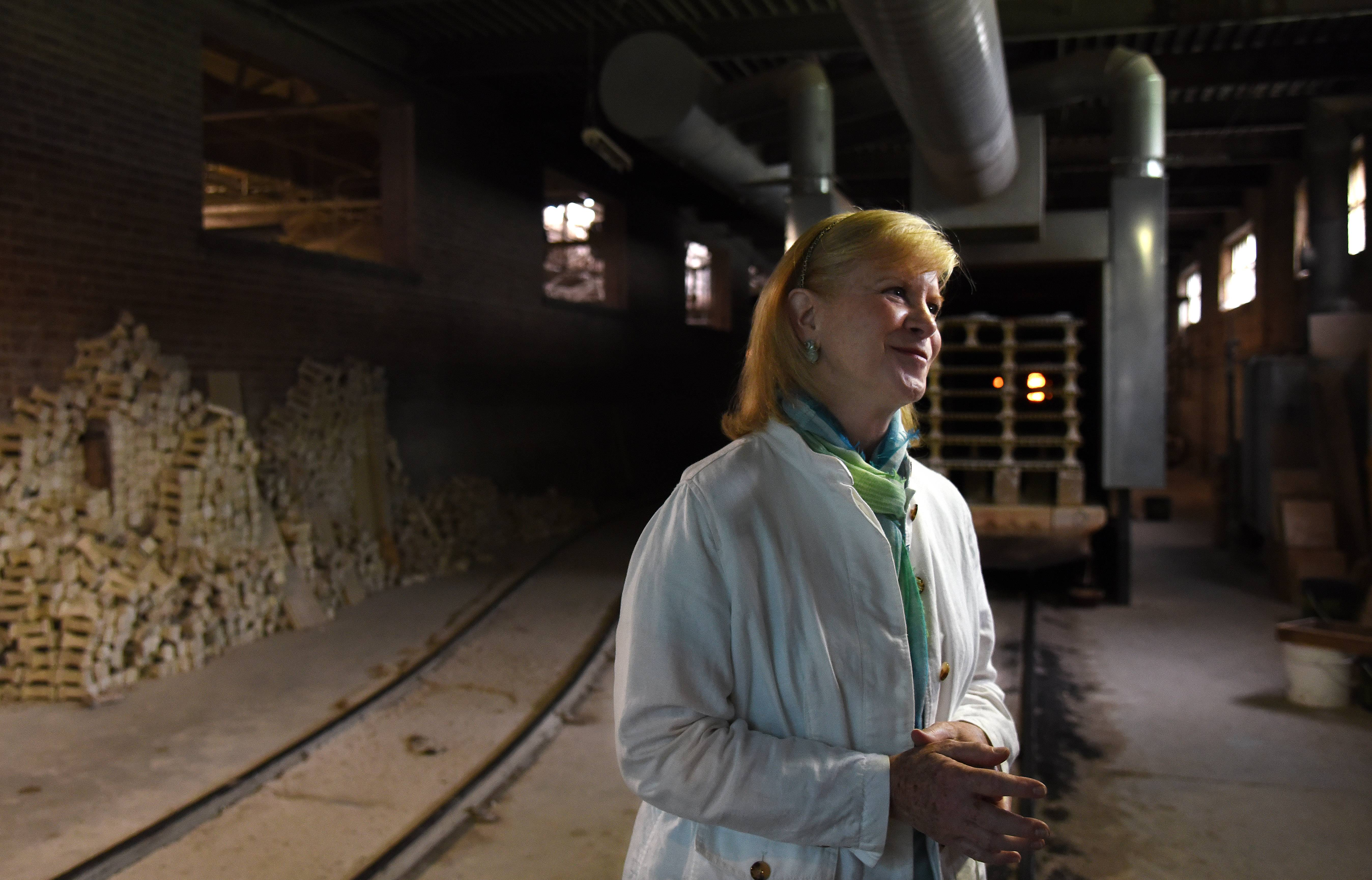 Lexy Haeger Estes stands near the kiln area at Haeger Potteries in East Dundee weeks before the factory closed its doors for good. The company, which has been in her family four generations, ceased operations at the end of June.
