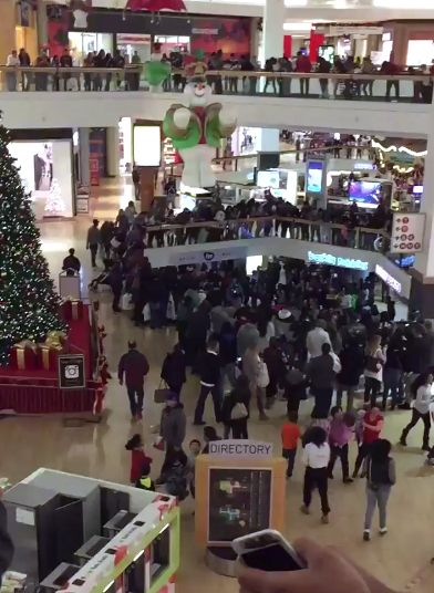 This image from a Twitter video shows some of a large crowd inside Fox Valley Mall being broken up by police Monday night in Aurora.